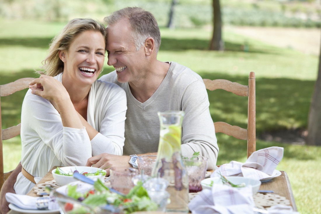 Cheerful couple enjoying healthy meal