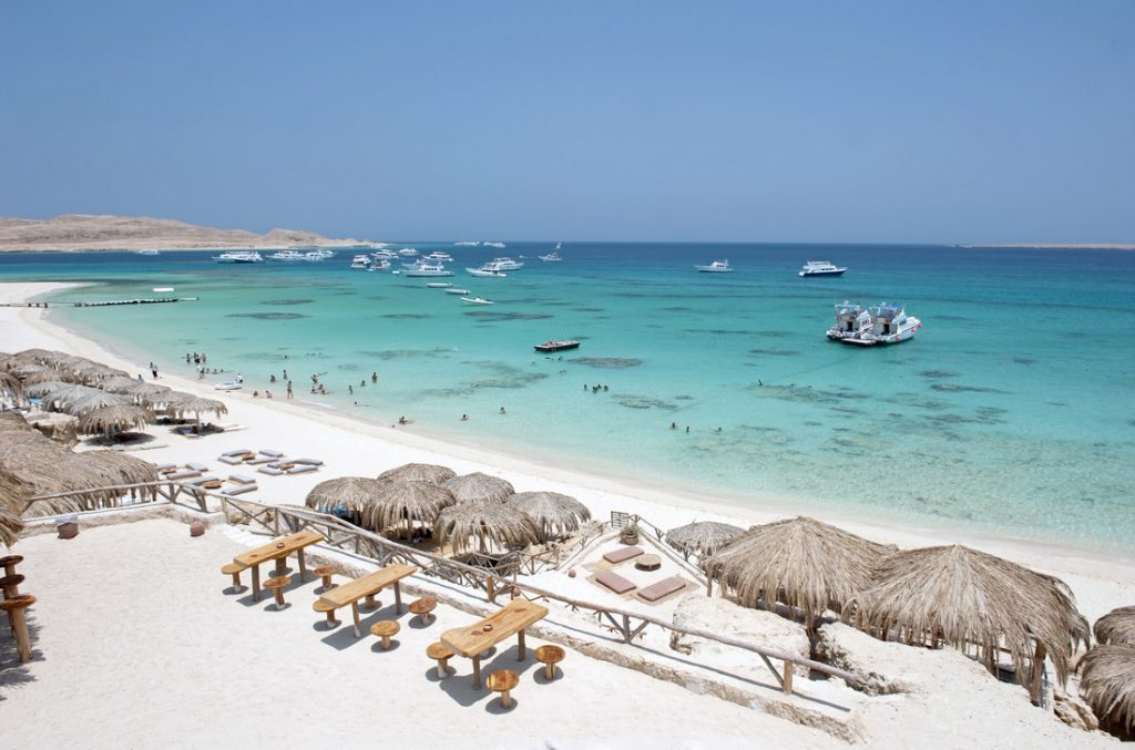 egypt white sand blue sea beach, one of the best destinations to visit in spring