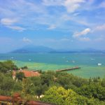 View out over the Sirmione peninsula and Jamaica beach. One of the best places to visit in Lake Garda. With SpaDreams