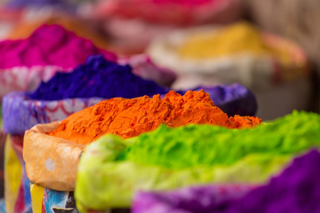 Colorful piles of powdered dyes used for Holi festival in India.