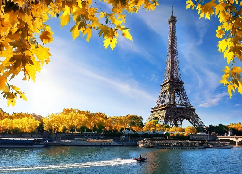 Paris in Fall, autumn. One indoor activity is a film night, stay cozy indoors at home whilst exploring foreign cities through film.