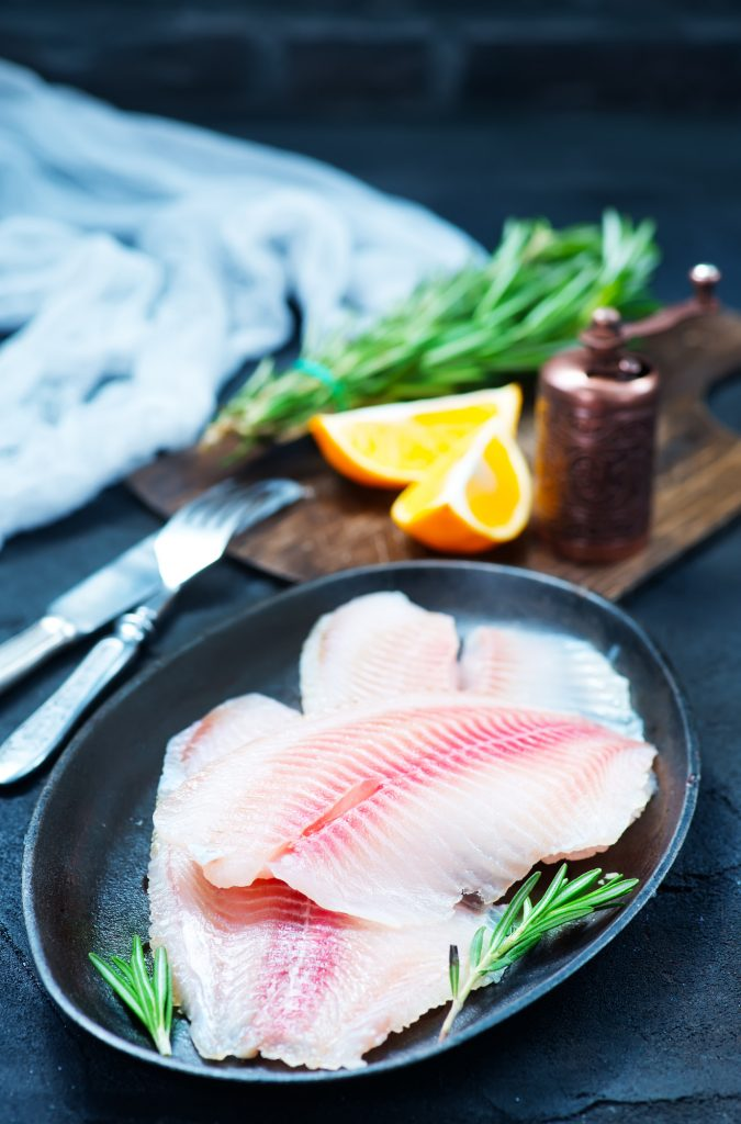 raw fish with spice and on a table