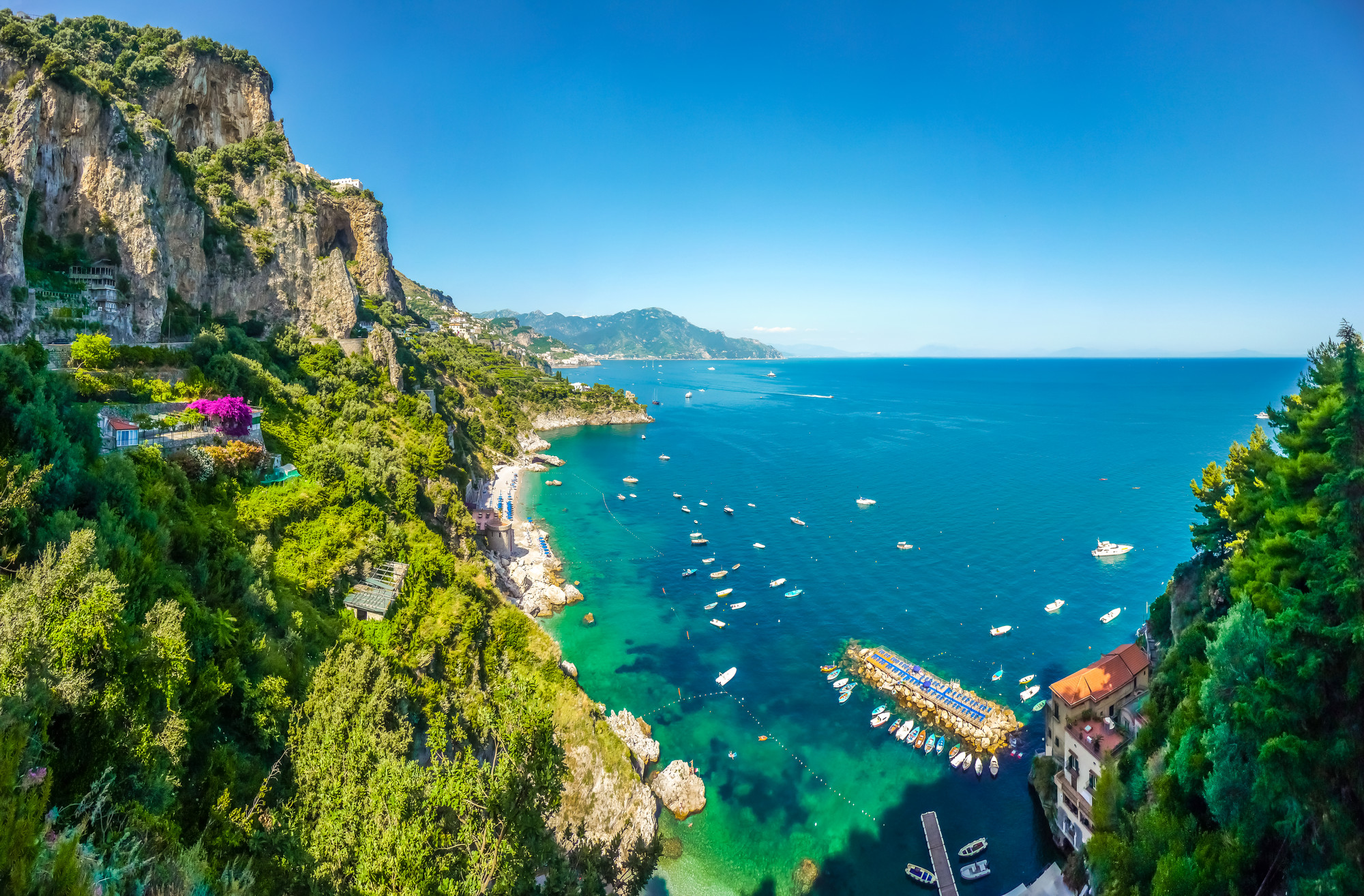 Scenic picture-postcard view of famous Amalfi Coast with beautiful Gulf of Salerno, Campania, Italy. Ischia, island of thermal springs.