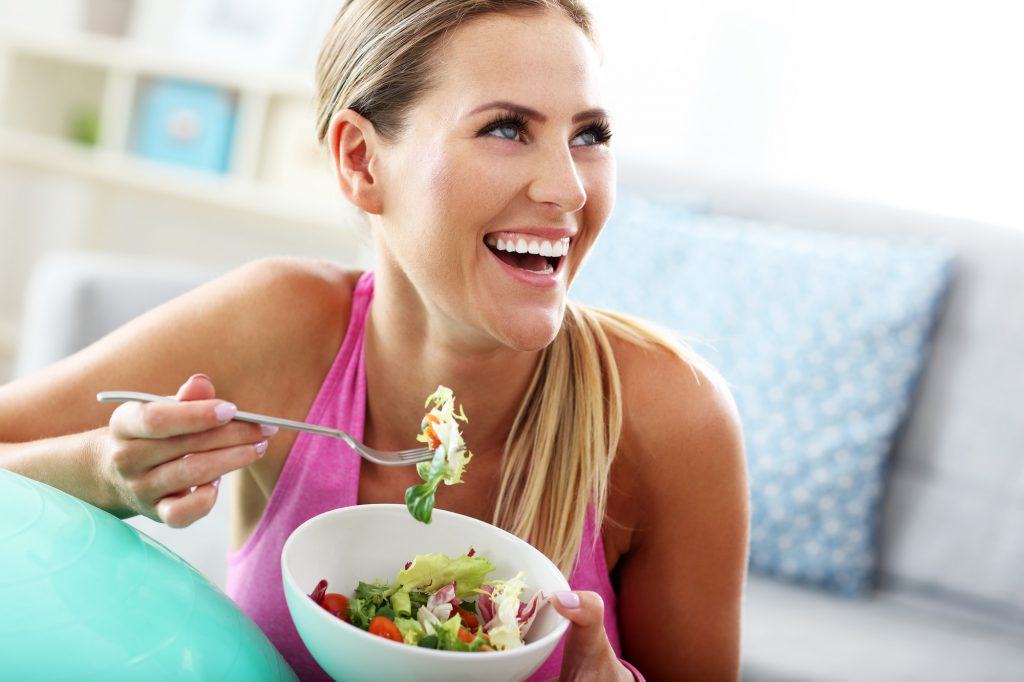 young woman eating a salad suitable for the pegan diet