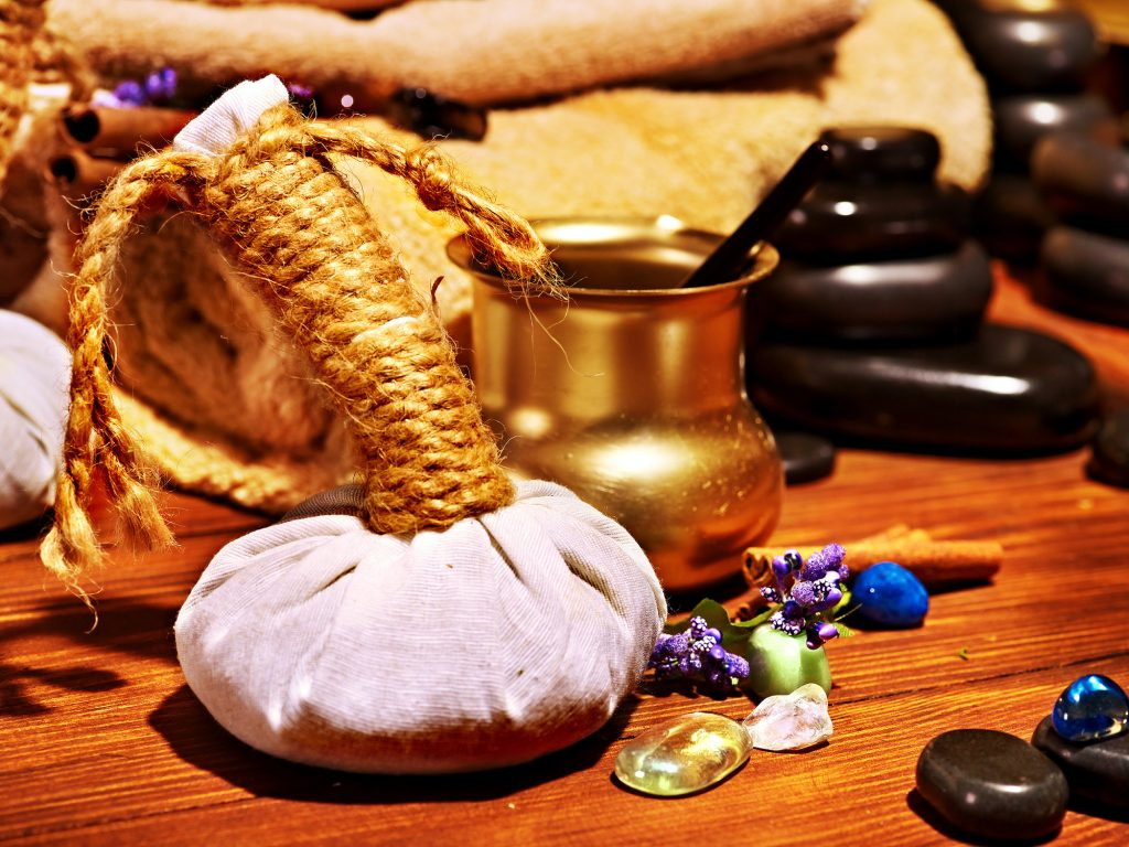 herbal stamp, stones and oils for Ayurveda treatments